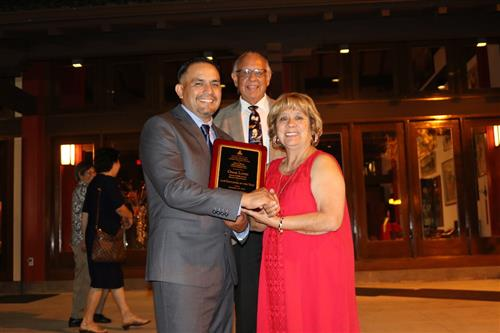 Mr. Lopez receiving the educator of the year award